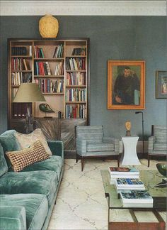 Love the wall color and the blue green velvet sofa