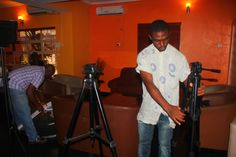 Crew member,Kunle Adeojo and Wale Olosunde setting up the studio in preparetion for the interview