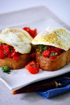 A bold brunch idea from DeLallo.com // Fresh Tomato #Bruschetta with Fried Eggs #fresh #entertain #Italian