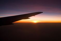 Aerial View of Wing of Commercial Passenger Plane (Boeing 767) Silhouetted Against Sunset over n/w corner (Ningaloo Reef) of Western Australia