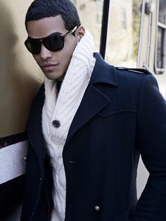 Clyde J. Folborg...chunky white high collar sweater and military style black coat