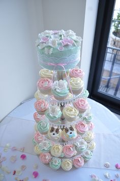 Tiffany blue, pale pink and cream wedding cupcakes, via Flickr.