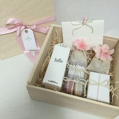 Pink and white teacher appreciation gift | gift card | pink satin ribbon | natural wood box with cover | custom gift box | pink French macaron | boxed water | white pearl candy | pink flowers | Barbona gifts | twine | excelsior wood | gift ideas for teachers