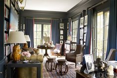 """Julia Reed, """"House Tour: Is This The Chicest Home In Nashville?"""" Elle Decor (July/August 2014): 116–23. Library of the Belle Meade home of Jon and Keith Meacham. Interior design by Brockschmidt & Coleman. Photo by William Waldron."""