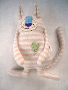 Cashmere Stuffed Animal Cat Upcycled Striped Sweater Pink and Cream Repurposed    I made this sweet cat from one of the best sweaters ever. The colors are just so soft, they remind me of strawberries and cream. I just love this silly little guy. He is just about 10 inches tall and about 6 inches wide.    This sweet kitty was inspired by my own sweet kitty brothers, Poppy and Rory. Just looking at his adorable face with his funny little fangs makes me smile. This little guy is approximately…