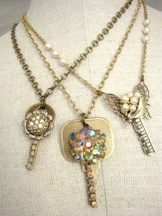 Decorate old keys with costume jewelry and turn into a necklace. Now i know what to do with all those vintage keys and pins i got. SCORE!