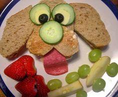 I made a cute dog face sandwich and apple cars.
