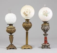 Victorian brass banquet lamps.  I have one almost like the lamp in the middle, except my shade is different.