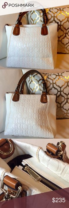 NWOT CAROLINA HERRERA Large HANDBAG New with out tags: A brand-new, unused,  CAROLINA HERRERA Color:White and brown Style:Hobo Size:LargeMaterial:PVC and leather Carolina Herrera Bags Hobos
