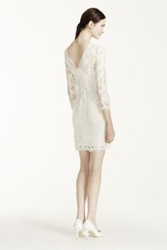 Stand out on your special day in this simple yet unforgettable illusion sleevelace V-back casual weddingdress!  Short all over lace dress features illusion 3/4 sleeves and a sultry V-back foradded elegance and allure.  At the knee hem line not only offers a chic take the typical bridal gown, buteasily and comfortablytransitionsfrom ceremony to reception.  This gown looks stunning on it's own, but can easily be dressed up with accessories for a more dramati...