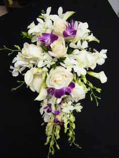 Elegant bouquet of orchids, roses, and mini calla lillies