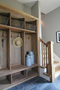 cubbies- have with out-of-season flip through a hinged closet system. The board with hooks can be slipped off of notch to enter. Inside would be a few hinged coat hangers (for bulky winter and rain coats & pants), a clothing ladder (for draping the less bulky outdoor clothing), and a peg-hole rack (for things like hats, scarves etc.).