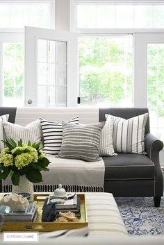 Create a casual and elegant summer living room with calming neutrals, layers of textures and hints on blue and white for a relaxing, laid-back look. Living Room Modern, Living Room Designs, Living Room Decor, Living Rooms, Elegant Home Decor, Elegant Homes, Boho Home, White Sofas, Home Decor Styles