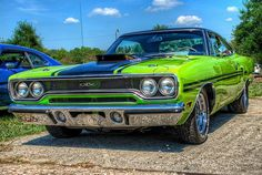 "CHRYSLER PLYMOUTH GTX circa.1970 ""The Gentlemen's Muscle Car""in ""psychedelic green"" sporting a 440 cid 4bbl V-8,""POWER BULGE hood"" moulded air grabber hood scoop, and functional rear brakes cooling air scoops!"
