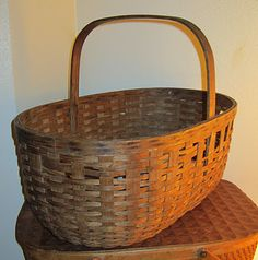 Beautiful old basket I found at Goodwill full of plastic play food.  Paid five bucks for it - and handed the food right back to the donation bin.