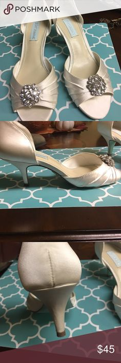 Betsey Johnson wedding shoes Wore once in outdoor wedding! Super cute small heal easy to walk in. Cute bling on front! Small red mark, hardly noticeable. More of a pearl white Betsey Johnson Shoes Heels