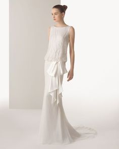 This Art Nouveau inspired dress features a low blouson top leading to a drop waist tied with a loose bow. | See more Spring 2015 wedding dress trends here: http://www.mywedding.com/articles/spring-2015-wedding-dresses-favorite-trends/?utm_source=pinterest&utm_medium=social&utm_campaign=fashion_style