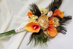 Wedding flowers Orange peacock Bridal Bouquet Ready to Ship peacock feather Wedding accessories fall autumn. $118.95, via Etsy.