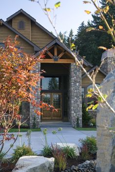 Beautiful entry into this new home with Japanese maple, a gable roof and a circular driveway. You will also notice the well attended landscaping. Did you know landscaping can reduce traffic noise?