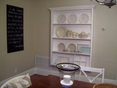 This was not the point of her blog, but I like the idea of this shelf, just maybe smaller with 2 shelves, a 4 inch bump out with wainscoting in the back for pretty platters and serving dishes... must maximize use of space!