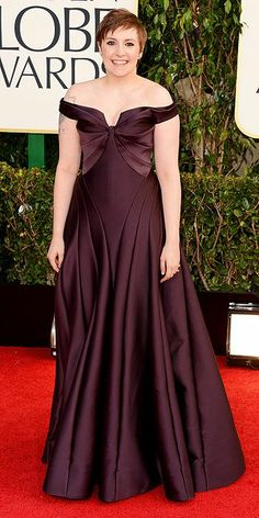 Lena Dunham. It seems to me that her goal is to never wear flattering clothing. The dress is lovely but the shoulders part is off.