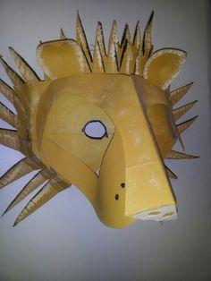 Lion cardboard mask by Kitchen sink arts