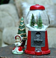 Who needs gumballs when you can make a gumball machine into the perfect DIY snow globe? @petticoatjunk shares with us just how to do it! One of the best parts is you can change the scenery inside to fit any holiday! Or spray paint the base for a look to match your decor! http://www.rustoleum.com/product-catalog/consumer-brands/painters-touch-ultra-cover-2x/gloss