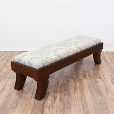 This Klismos style bench is featured in a solid wood medium cherry finish. This long bench is in great condition with carved curved feet and a paisley print upholstered seat cushion in white, blue and green. Stylish contemporary ottoman perfect for the end of a bed! #contemporary #chairs #bench #sandiegovintage #vintagefurniture