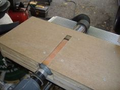 Drum Sander - Homemade lathe-driven drum sander constructed from plywood and hardboard.