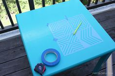 Grab your paints and tape! Create a beautiful stenciled wooden table with a few simple steps.