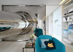 Penthouse apartment with tubular steel slide, glass attic and quadruple-height living room by David Hotson and Ghislaine Viñas.