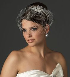 I do like this look.. I just don't want a veil over my eyes and I don't want something flipping back over my head if it's windy... decisions, decisions. #birdcage #headband #bride