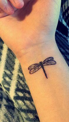 Dragonfly tattoo, wrist.