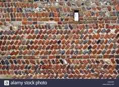 Stock Photo - Mixed brick and stonework wall at the old Rathfinny farmhouse near Alfriston, East Sussex, UK