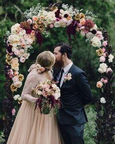 dark and romantic ceremony florals