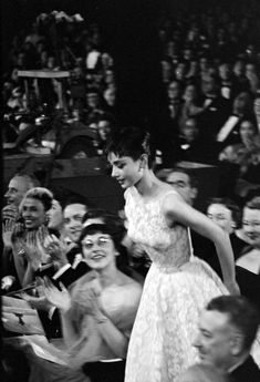 "Audrey Hepburn in 1954, winning her first Oscar for ""Roman Holiday"" and wearing a dress by Edith Head and Givenchy."
