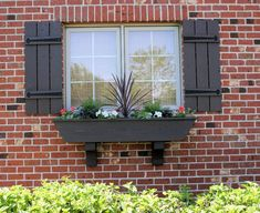 wooden shutters and flower box
