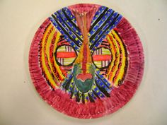 Adinkra masks on paper plates