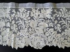 19th c Point d'Angleterre, which is a fine Belgian bobbinlace with Point de Gaze ground and decorative needle-made fillings.