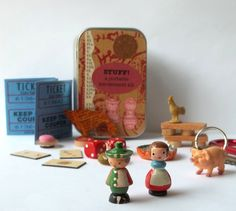 Toy set in a tin, pocket size amusement kit for kids, with vintage Sevi figures, wooden game pieces, and other random items.