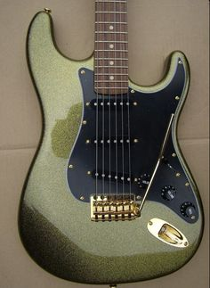 Olive Green black electric guitar - I'd love to have a guitar like this. Can't seem to find anything like this though.