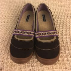 Lands End shoes. Size 6 Chocolate brown suede with purple strap across the top. Rubber soles. Very comfortable. These are size 6 but fit a little bigger-more like a 6.5. Warm and cute!! Great condition. Lands' End Shoes