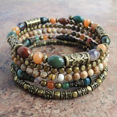 This lovely 5-loop memory wire bracelet was designed and handcrafted in my studio by combining natural semi-precious gemstone beads - Fancy Jasper in multi colors of mauve, maroon, brown, green, and gray, Peach Aventurine in a warm apricot orange, and Picture Jasper in wood-like