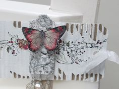 Love how the butterfly is covered with Diamond Dust or similar on this tag.