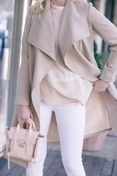 neutral coat with white denim and neutral bag