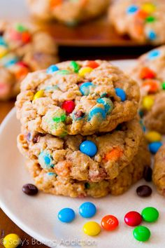 Favorite super chewy and soft oatmeal cookies loaded with M+M candies! Recipe by sallysbakingaddiction.com