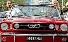 British entertainer Si Cranstoun and Miss Kitten Darling were cruising around in a vintage Mustang checking out the car talent.