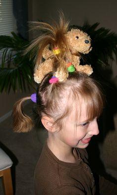 Crazy Hair Day for school. Add a small stuffed animal around pony tail. Maybe a monkey.