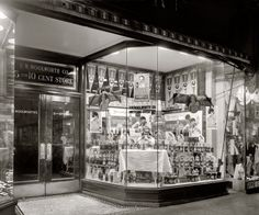 "Washington, D.C., circa 1921. ""Whistle Bottling Works. Woolworth window."" An elaborate dime-store window display for Whistle orange soda, ""the food drink."" National Photo Company Collection glass negative"