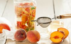 """Inspired by the idea of """"nose-to-tail eating,"""" we've devised a clever way to use the trimmings from summer's fresh fruits and vegetables - transform them into refreshing flavored waters! This infused water takes on the color of the peaches as well as their sweet taste, while ginger adds warmth"""